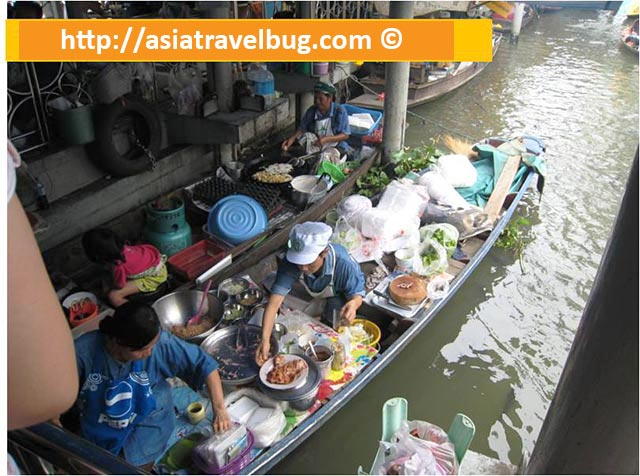 A Boat Vendor Selling Cooked Meals in Taling Chan Floating Market