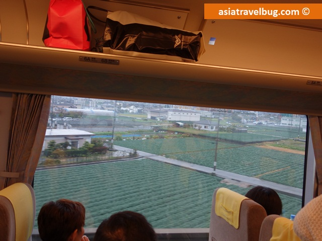 Haruka Train Passing Through Rice Paddies in Kyoto from Kansai Airport