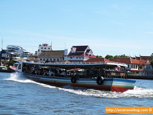 Tourists in Chao Phraya River Heading to Bangkok Tourist Spots