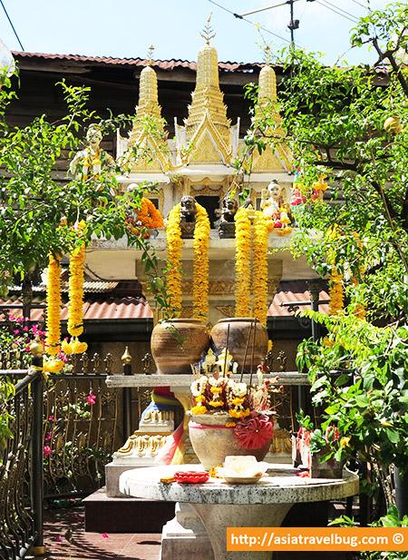 Spirit Houses Outside Homes in Thonburi